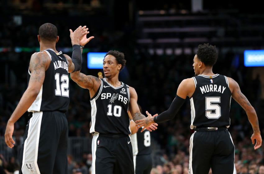 BOSTON, MASSACHUSETTS - JANUARY 08: DeMar DeRozan #10 of the San Antonio Spurs celebrates with LaMarcus Aldridge #12 and Dejounte Murray #5 during the game against the Boston Celtics at TD Garden. (Photo by Maddie Meyer/Getty Images)