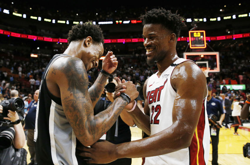 MIAMI, FLORIDA - JANUARY 15: Jimmy Butler #22 of the Miami Heat greets DeMar DeRozan #10 of the San Antonio Spurs after the game at American Airlines Arena on January 15, 2020 in Miami, Florida. NOTE TO USER: User expressly acknowledges and agrees that, by downloading and/or using this photograph, user is consenting to the terms and conditions of the Getty Images License Agreement. (Photo by Michael Reaves/Getty Images)