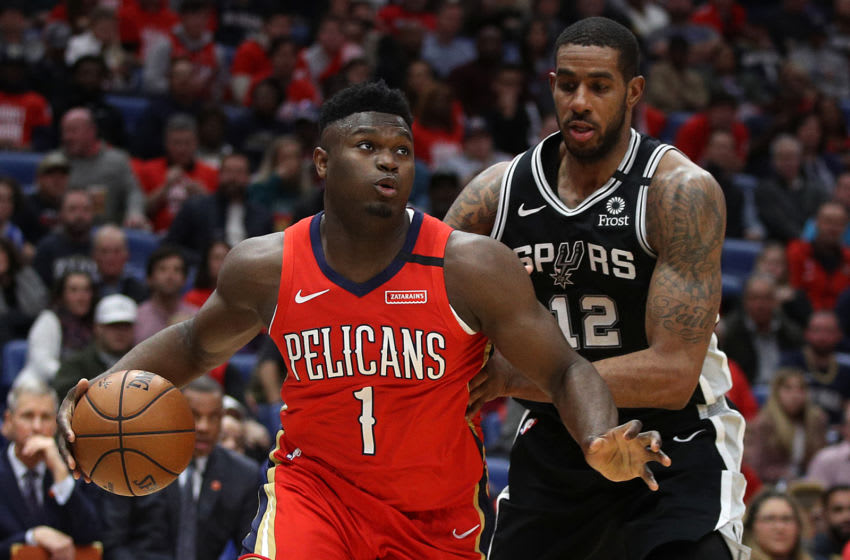 NEW ORLEANS, LOUISIANA - JANUARY 22: Zion Williamson #1 of the New Orleans Pelicans drives the ball around LaMarcus Aldridge #12 of the San Antonio Spurs at Smoothie King Center on January 22, 2020 (Photo by Chris Graythen/Getty Images)