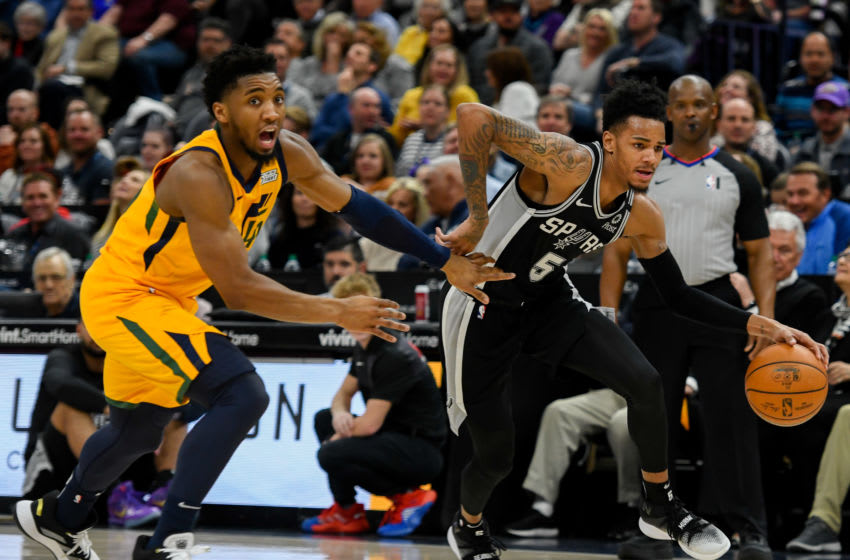 SALT LAKE CITY, UT - FEBRUARY 21: Dejounte Murray #5 of the San Antonio Spurs drives past Donovan Mitchell #45 of the Utah Jazz during a game at Vivint Smart Home Arena on February 21, 2020 in Salt Lake City, Utah. NOTE TO USER: User expressly acknowledges and agrees that, by downloading and/or using this photograph, user is consenting to the terms and conditions of the Getty Images License Agreement. (Photo by Alex Goodlett/Getty Images)