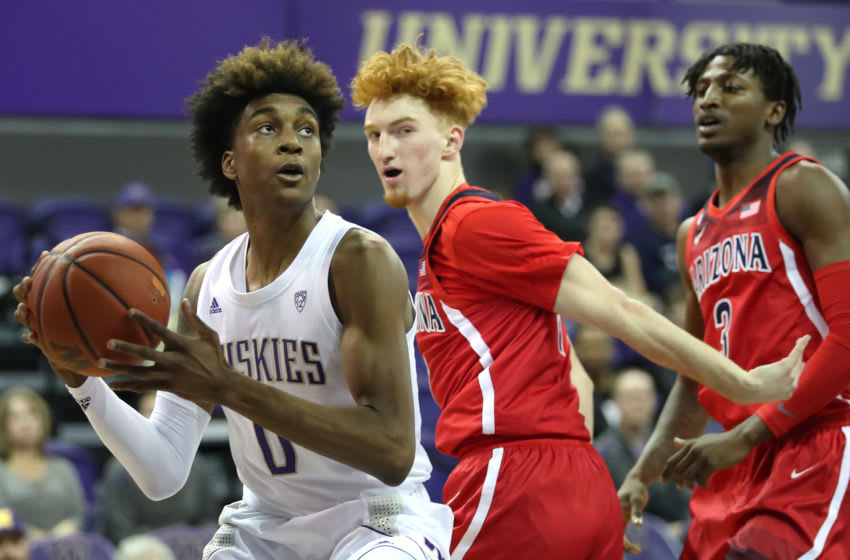 SEATTLE, WASHINGTON - JANUARY 30: Jaden McDaniels #0 of the Washington Huskies works towards the basket against Nico Mannion #1 of the Arizona Wildcats in the first half at Hec Edmundson Pavilion on January 30, 2020 in Seattle, Washington. (Photo by Abbie Parr/Getty Images)