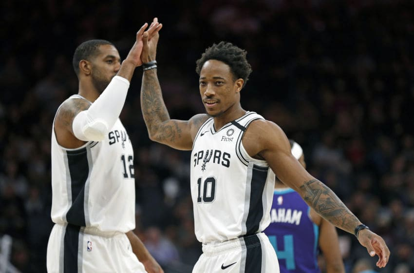 SAN ANTONIO, TX - FEBRUARY 01: DeMar DeRozan #10 of the San Antonio Spurs is high fives by teammate LaMarcus Aldridge #12 after a basket during first half action at AT&T Center (Photo by Ronald Cortes/Getty Images)