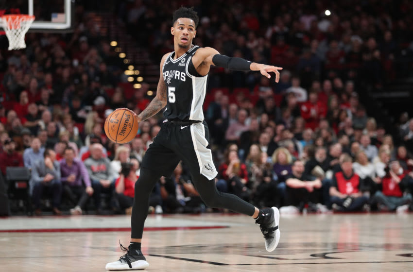 PORTLAND, OREGON - FEBRUARY 06: Dejounte Murray #5 of the San Antonio Spurs dribbles with the ball in the first quarter against the Portland Trail Blazers during their game at Moda Center on February 06, 2020 in Portland, Oregon. NOTE TO USER: User expressly acknowledges and agrees that, by downloading and or using this photograph, User is consenting to the terms and conditions of the Getty Images License Agreement. (Photo by Abbie Parr/Getty Images)