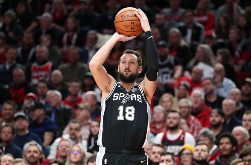 PORTLAND, OREGON - FEBRUARY 06: Marco Belinelli #18 of the San Antonio Spurs takes a shot against the Portland Trail Blazers in the second quarter during their game at Moda Center (Photo by Abbie Parr/Getty Images)