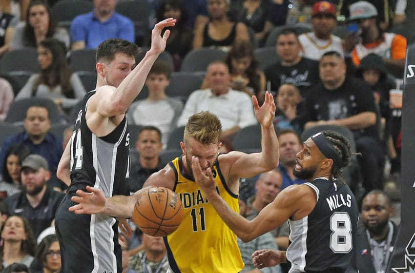 SAN ANTONIO, TX - MARCH 02: Patty Mills #8 of the San Antonio Spurs fouls Domantas Sabonis #11 of the Indiana Pacers during first half action at AT&T Center on March 02, 2020 in San Antonio, Texas. NOTE TO USER: User expressly acknowledges and agrees that , by downloading and or using this photograph, User is consenting to the terms and conditions of the Getty Images License Agreement. (Photo by Ronald Cortes/Getty Images)