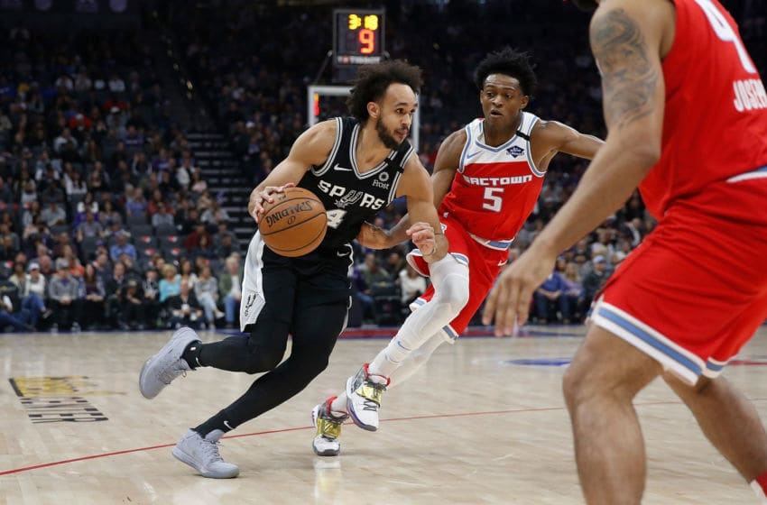 SACRAMENTO, CALIFORNIA - FEBRUARY 08: Derrick White #4 of the San Antonio Spurs goes to the basket against De'Aaron Fox #5 of the Sacramento Kings in the first half at Golden 1 Center on February 08, 2020 in Sacramento, California. NOTE TO USER: User expressly acknowledges and agrees that, by downloading and/or using this photograph, user is consenting to the terms and conditions of the Getty Images License Agreement. (Photo by Lachlan Cunningham/Getty Images)