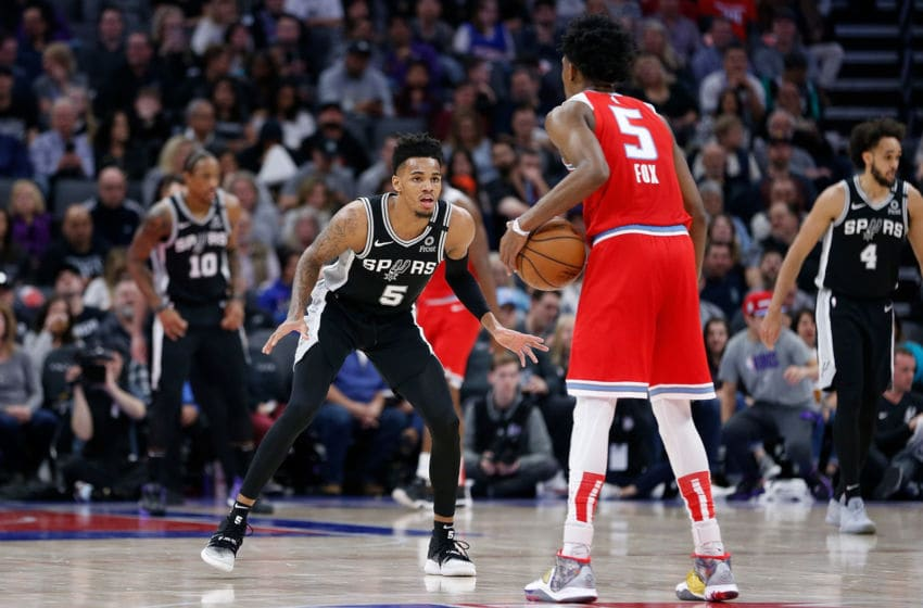 SACRAMENTO, CALIFORNIA - FEBRUARY 08: Dejounte Murray #5 of the San Antonio Spurs guards De'Aaron Fox #5 of the Sacramento Kings in the first half at Golden 1 Center on February 08, 2020 in Sacramento, California. NOTE TO USER: User expressly acknowledges and agrees that, by downloading and/or using this photograph, user is consenting to the terms and conditions of the Getty Images License Agreement. (Photo by Lachlan Cunningham/Getty Images)