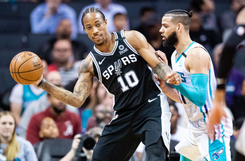 CHARLOTTE, NORTH CAROLINA - MARCH 03: DeMar DeRozan #10 of the San Antonio Spurs is defended by Cody Martin #11 of the Charlotte Hornets during the third quarter of their game (Photo by Jacob Kupferman/Getty Images)