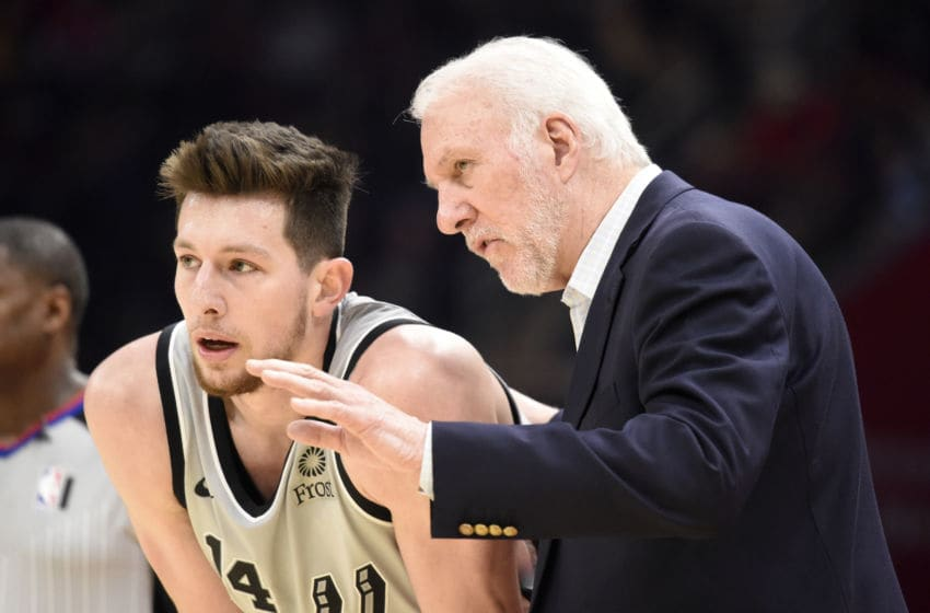 CLEVELAND, OHIO - MARCH 08: Drew Eubanks #14 listens to Head coach Gregg Popovich of the San Antonio Spurs during the second half against the Cleveland Cavaliers at Rocket Mortgage Fieldhouse on March 08, 2020 (Photo by Jason Miller/Getty Images)