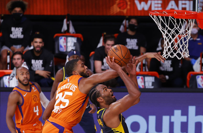 LAKE BUENA VISTA, FLORIDA - AUGUST 06: T.J. Warren #1 of the Indiana Pacers and Mikal Bridges #25 of the Phoenix Suns join three San Antonio Spurs players on Air Alamo's NBA Bubble All-Stars roster. (Photo by Kevin C. Cox/Getty Images)