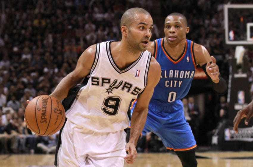 SAN ANTONIO, TX - MAY 29: Tony Parker #9 of the San Antonio Spurs drives ahead of Russell Westbrook #0 of the Oklahoma City Thunder in Game Two of the Western Conference Finals of the 2012 NBA Playoffs at AT&T Center on May 29, 2012 in San Antonio, Texas. NOTE TO USER: User expressly acknowledges and agrees that, by downloading and or using this photograph, user is consenting to the terms and conditions of the Getty Images License Agreement. (Photo by Ronald Martinez/Getty Images)