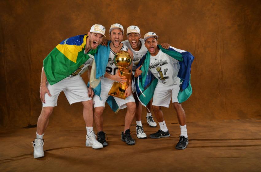 Tiago Splitter, Manu Ginobili , Boris Diaw and Patty Mills of the San Antonio Spurs. (Photo by Jesse D. Garrabrant/NBAE via Getty Images)