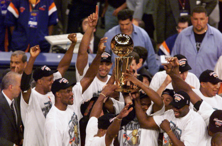 UNITED STATES - JUNE 25: San Antonio Spurs hold up trophy after Spurs beat the New York Knicks, 78-77, in Game 5 to win the NBA Finals at Madison Square Garden. (Photo by Linda Cataffo/NY Daily News Archive via Getty Images)