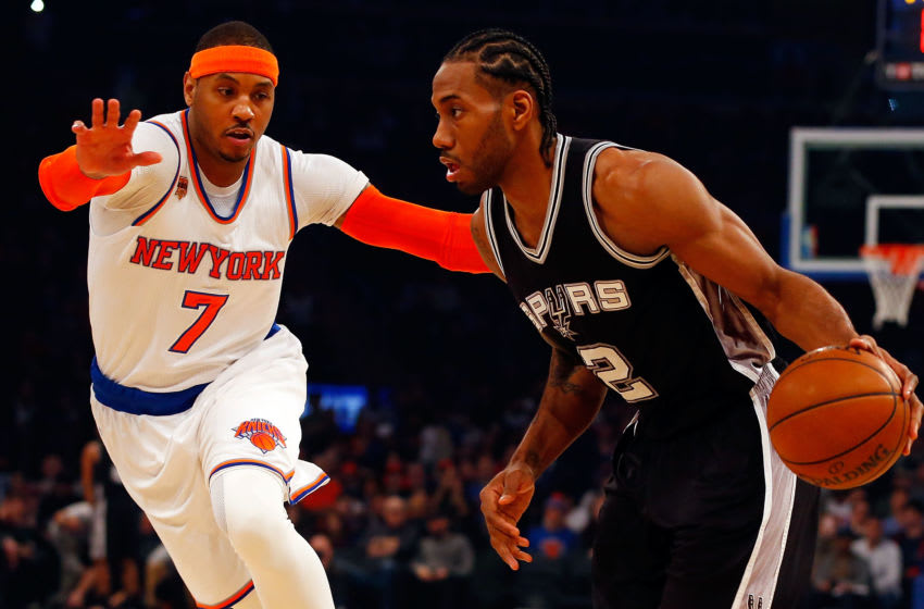 NEW YORK, NY - FEBRUARY 12: (NEW YORK DAILIES OUT) Kawhi Leonard #2 of the San Antonio Spurs in action against Carmelo Anthony #7 of the New York Knicks at Madison Square Garden on February 12, 2017 in New York City. The Knicks defeated the Spurs 94-90. NOTE TO USER: User expressly acknowledges and agrees that, by downloading and/or using this Photograph, user is consenting to the terms and conditions of the Getty Images License Agreement. (Photo by Jim McIsaac/Getty Images)