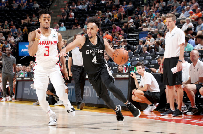 SALT LAKE CITY, UT - JULY 3: Derrick White #4 of the San Antonio Spurs handles the ball against the Atlanta Hawks during the 2018 Utah Summer League on July 3, 2018 at Vivint Smart Home Arena in Salt Lake City, Utah. NOTE TO USER: User expressly acknowledges and agrees that, by downloading and or using this Photograph, User is consenting to the terms and conditions of the Getty Images License Agreement. Mandatory Copyright Notice: Copyright 2018 NBAE (Photo by Joe Murphy/NBAE via Getty Images)