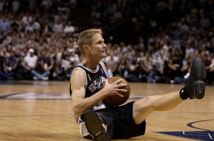 EAST RUTHERFORD, NJ - JUNE 13: Steve Kerr #25 of the San Antonio Spurs holds the ball in Game five of the 2003 NBA Finals against the New Jersey Nets at Continental Airlines Arena on June 13, 2003 in East Rutherford, New Jersey. The Spurs won 93-83. NOTE TO USER: User expressly acknowledges and agrees that, by downloading and/or using this Photograph, User is consenting to the terms and conditions of the Getty Images License Agreement. (Photo by Ezra Shaw/Getty Images)