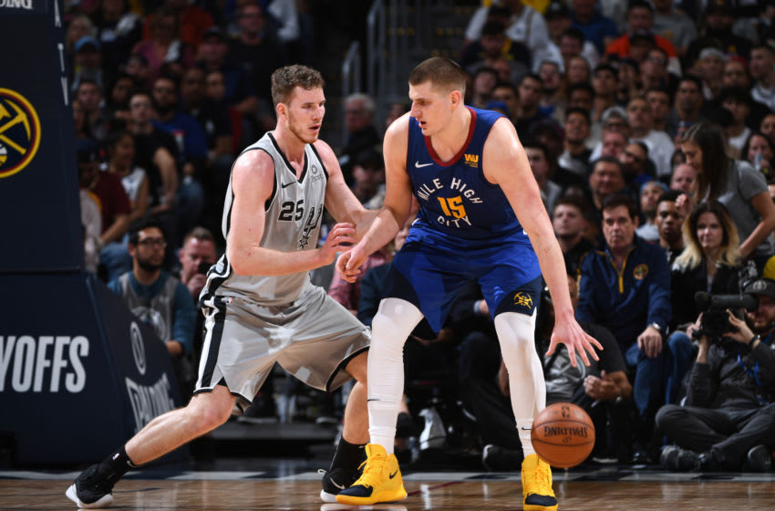 DENVER, CO - APRIL 23: Nikola Jokic #15 of the Denver Nuggets posts up on Jakob Poeltl #25 of the San Antonio Spurs during Game Five of Round One of the 2019 NBA Playoffson April 23, 2019 at the Pepsi Center in Denver, Colorado. NOTE TO USER: User expressly acknowledges and agrees that, by downloading and/or using this Photograph, user is consenting to the terms and conditions of the Getty Images License Agreement. Mandatory Copyright Notice: Copyright 2019 NBAE (Photo by Garrett Ellwood/NBAE via Getty Images)