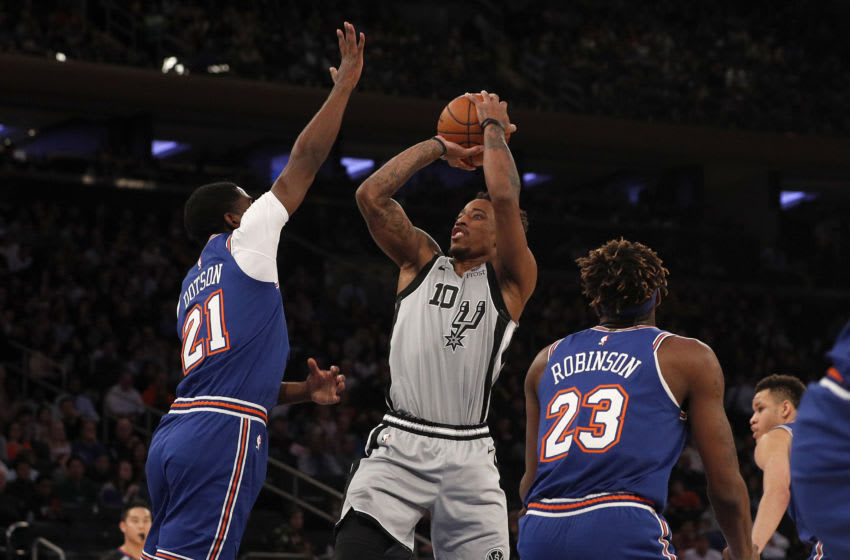 NEW YORK, NEW YORK - NOVEMBER 23: (NEW YORK DAILIES OUT) DeMar DeRozan #10 of the San Antonio Spurs in action against Damyean Dotson #21 of the New York Knicks at Madison Square Garden. (Photo by Jim McIsaac/Getty Images)