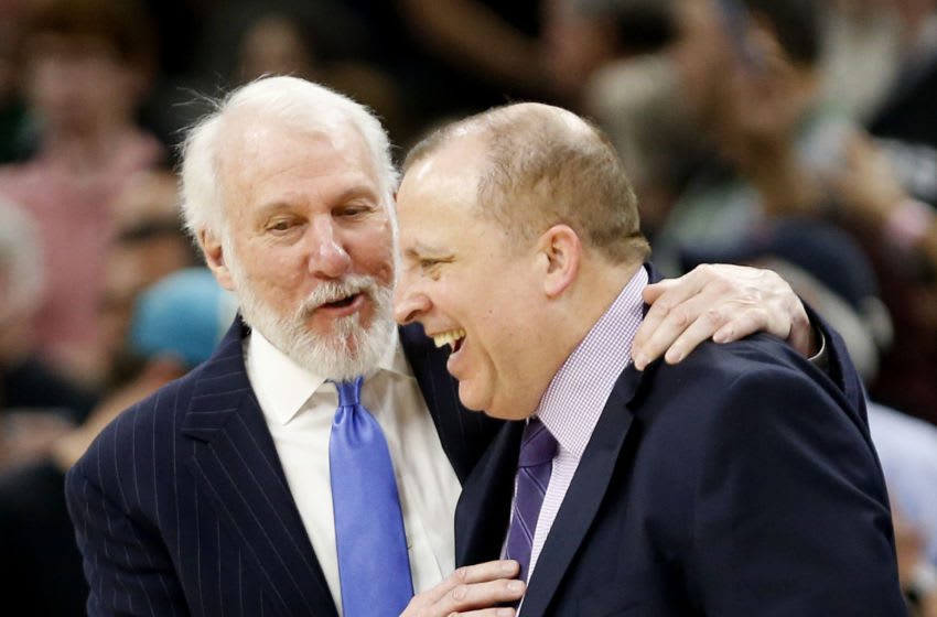 SAN ANTONIO,TX - MARCH 17 : Gregg Popvich head coach of the San Antonio Spurs talks with Tom Thibodeau head coach of the Minnesota Timberwolves at the end of the game at AT&T Center on March 17, 2018 in San Antonio, Texas. NOTE TO USER: User expressly acknowledges and agrees that , by downloading and or using this photograph, User is consenting to the terms and conditions of the Getty Images License Agreement. (Photo by Ronald Cortes/Getty Images)