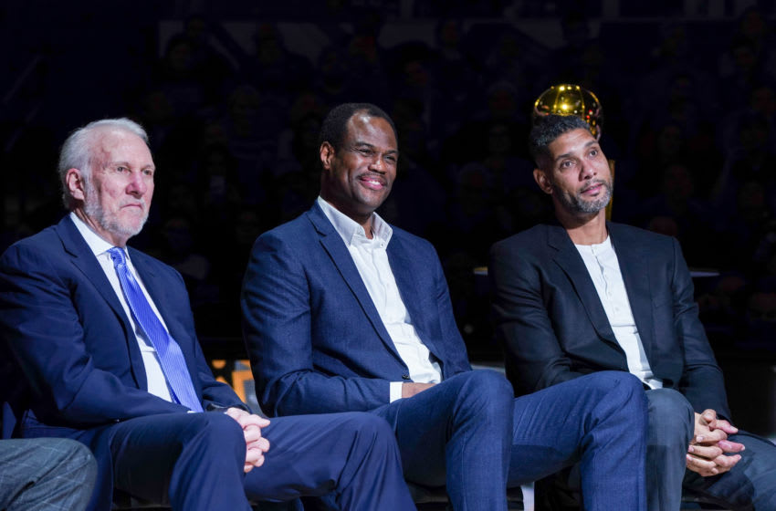 Nov 11, 2019; San Antonio, TX, USA; San Antonio Spurs head coach Gregg Popovich, and former Spurs players David Robinson and Tim Duncan look on during Tony Parker's retirement ceremony. Mandatory Credit: Daniel Dunn-USA TODAY Sports