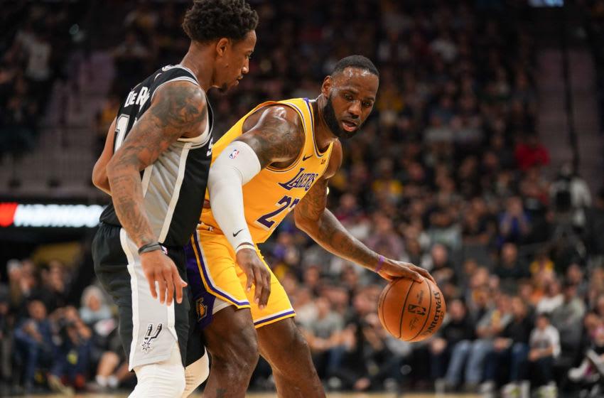 Nov 25, 2019; San Antonio, TX, USA; Los Angeles Lakers forward LeBron James (23) backs in against San Antonio Spurs guard DeMar DeRozan (10) in the second half at the AT&T Center. Mandatory Credit: Daniel Dunn-USA TODAY Sports