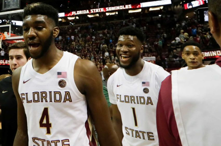 Florida State Seminoles forward Patrick Williams (4), who is consistently mocked to the San Antonio Spurs, Florida State Seminoles forward Raiquan Gray (1) and Florida State Seminoles guard Devin Vassell (24) celebrate a big victory over Virginia at the Donald L. Tucker Civic Center Wednesday, Jan. 15, 2020.