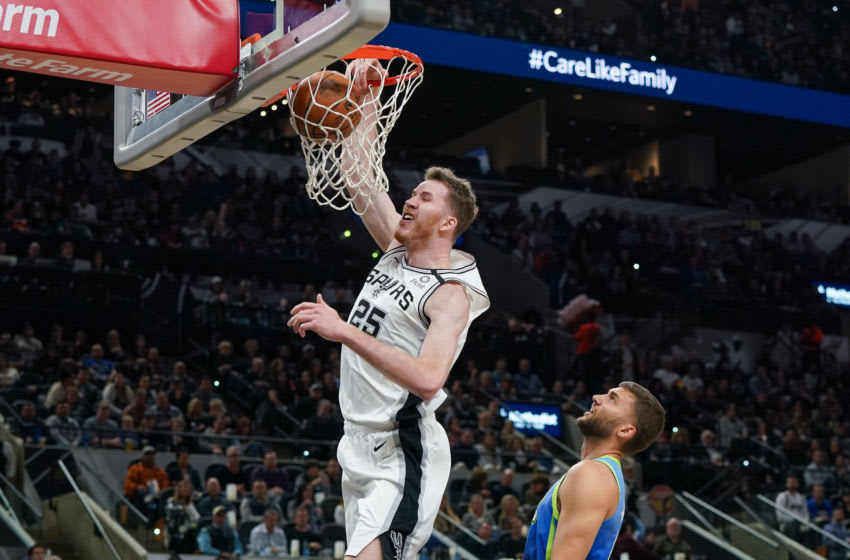 Feb 26, 2020; San Antonio, Texas, USA; San Antonio Spurs center Jakob Poeltl (25) dunks over Dallas Mavericks forward Maxi Kleber (42) in the first half at the AT&T Center. Mandatory Credit: Daniel Dunn-USA TODAY Sports