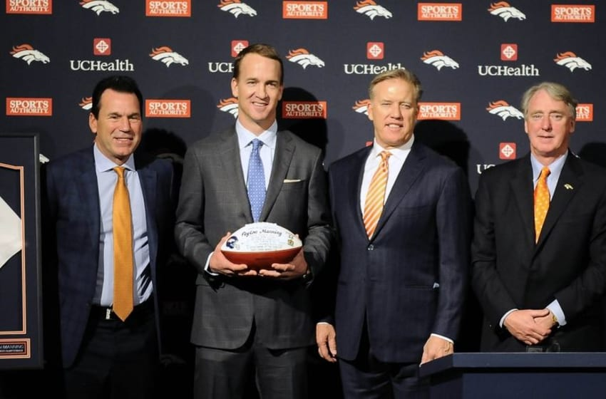 Mar 7, 2016; Englewood, CO, USA; From left, Denver Broncos head coach Gary Kubiak and quarterback Peyton Manning and general manager John Elway and president Joe Ellis pose for a photo during a press conference at the UCHealth Training Center. Mandatory Credit: Ron Chenoy-USA TODAY Sports