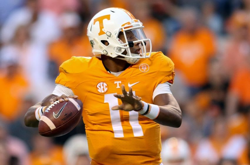 Sep 19, 2015; Knoxville, TN, USA; Tennessee Volunteers quarterback Joshua Dobbs (11) throws a touchdown pass to Tennessee Volunteers wide receiver Preston Williams (7) (not pictured) during the first quarter against the Western Carolina Catamounts at Neyland Stadium. Mandatory Credit: Randy Sartin-USA TODAY Sports