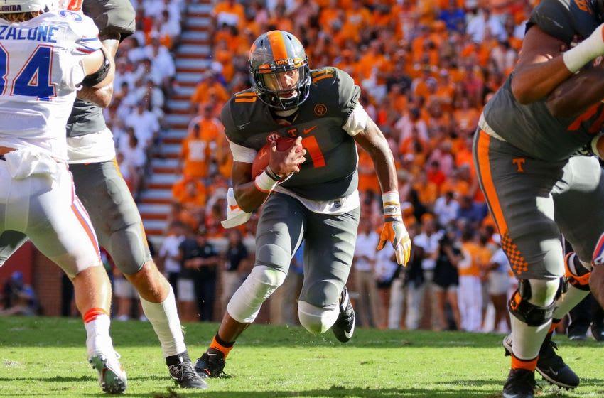 Sep 24, 2016; Knoxville, TN, USA; Tennessee Volunteers quarterback Joshua Dobbs (11) runs the ball against the Florida Gators during the second quarter at Neyland Stadium. Mandatory Credit: Randy Sartin-USA TODAY Sports