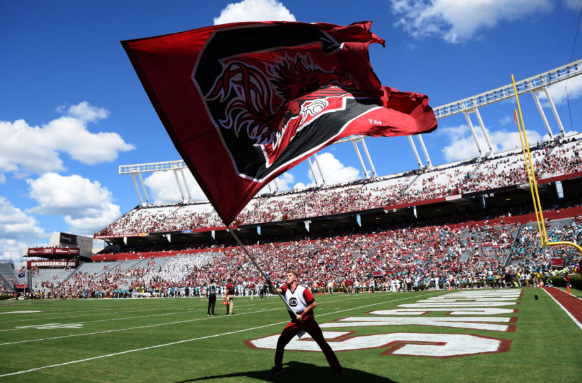 COLUMBIA, SC - SEPTEMBER 01: A cheerleader of the South Carolina Gamecocks waves a flag during their game against the Coastal Carolina Chanticleers at Williams-Brice Stadium on September 1, 2018 in Columbia, South Carolina. SC won 49-15. (Photo by Lance King/Getty Images)