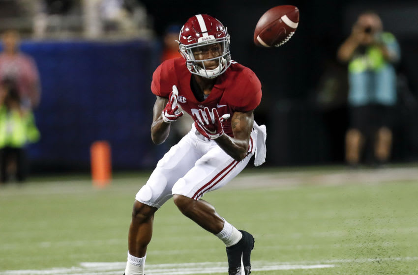 ORLANDO, FL - SEPTEMBER 1: Wide Receiver DeVonta Smith #6 of the Alabama Crimson Tide makes a catch during the game against the Louisville Cardinals during the Camping World Kickoff at Camping World Stadium on September 1, 2018 in Orlando, Florida. #1 ranked Alabama defeated Louisville 51 to 14. (Photo by Don Juan Moore/Getty Images)