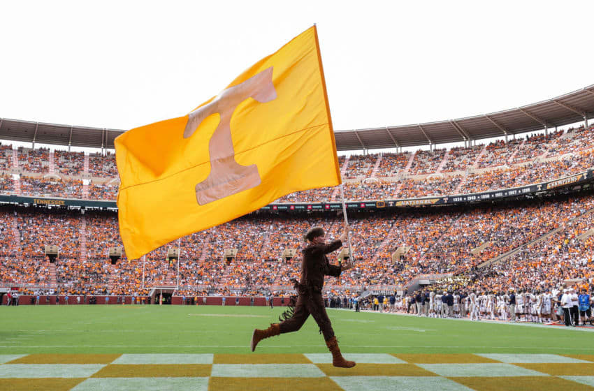 KNOXVILLE, TN - SEPTEMBER 08: Tennessee mascot Davy Crockett carries the flag across the end zone during a game between the Tennessee Volunteers and the East Tennessee State University Buccaneers at Neyland Stadium on September 8, 2018 in Knoxville, Tennessee. Tennesee won the game 59-3. (Photo by Donald Page/Getty Images)