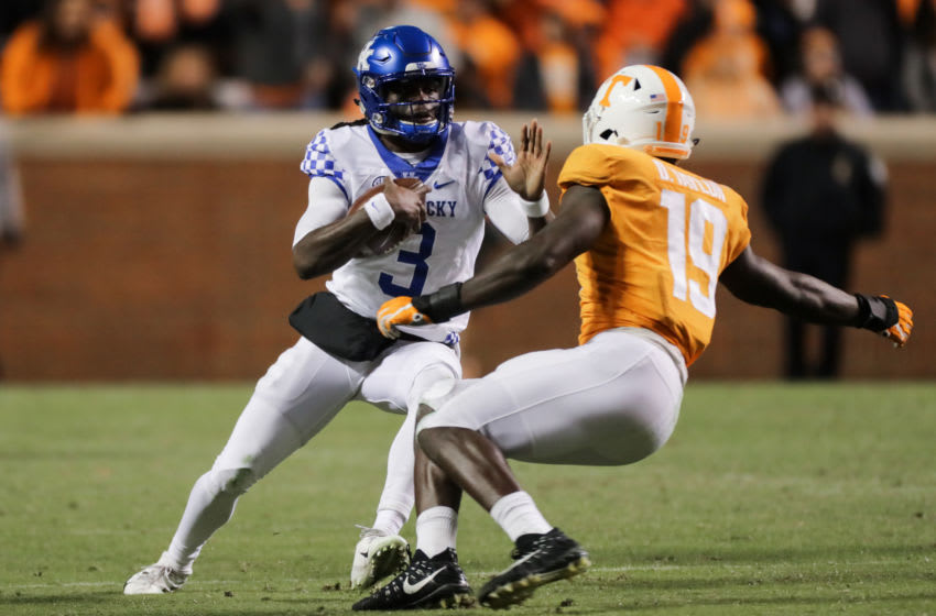 KNOXVILLE, TN - NOVEMBER 10: Terry Wilson #3 of the Kentucky Wildcats tries to avoid a tackle from Darrell Taylor #19 of the Tennessee Volunteers during the second half of the game between the Kentucky Wildcats and the Tennessee Volunteers at Neyland Stadium on November 10, 2018 in Knoxville, Tennessee. Tennessee won the game 24-7. (Photo by Donald Page/Getty Images)