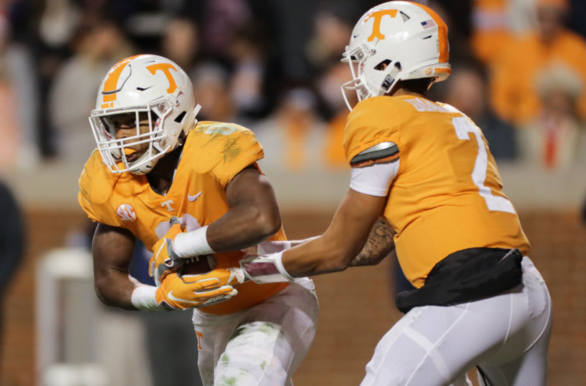 KNOXVILLE, TN - NOVEMBER 10: Ty Chandler #8 of the Tennessee Volunteers takes a hand off from Jarrett Guarantano #2 of the Tennessee Volunteers during the second half of the game between the Kentucky Wildcats and the Tennessee Volunteers at Neyland Stadium on November 10, 2018 in Knoxville, Tennessee. Tennessee won the game 24-7. (Photo by Donald Page/Getty Images)