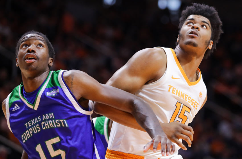 KNOXVILLE, TN - DECEMBER 2: Irshaad Hunte #15 of the Texas A&M-CC Islanders fights for position with Derrick Walker #15 of the Tennessee Volunteers during the second half of their game at Thompson-Boling Arena on December 2, 2018 in Knoxville, Tennessee. Tennessee won the game 79-51. (Photo by Donald Page/Getty Images)