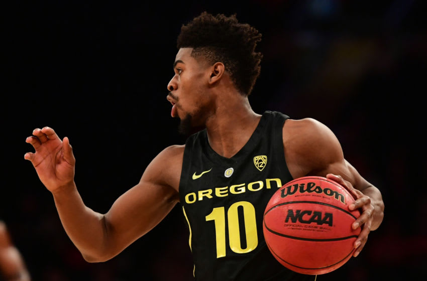 NEW YORK, NEW YORK - NOVEMBER 15: Victor Bailey Jr. #10 of the Oregon Ducks controls the ball during the first half of the game against Iowa Hawkeyes during the 2k Empire Classic at Madison Square Garden on November 15, 2018 in New York City. (Photo by Sarah Stier/Getty Images)