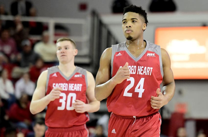 NEW YORK, NEW YORK - DECEMBER 22: E.J. Anosike #24 of the Sacred Heart Pioneers reacts against the St. John's Red Storm at Carnesecca Arena on December 22, 2018 in New York City. (Photo by Steven Ryan/Getty Images)