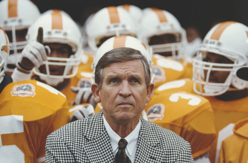 Johnny Majors, Head Coach for the University of Tennessee Volunteers stands with his team during the NCAA Southeastern Conference college football game against the University of Notre Dame Fighting Irish on 10 November 1990 at the Neyland Stadium in Knoxville, Tennessee, United States. Notre Dame won the game 34 - 29. (Photo by Rick Stewart/Allsport/Getty Images)