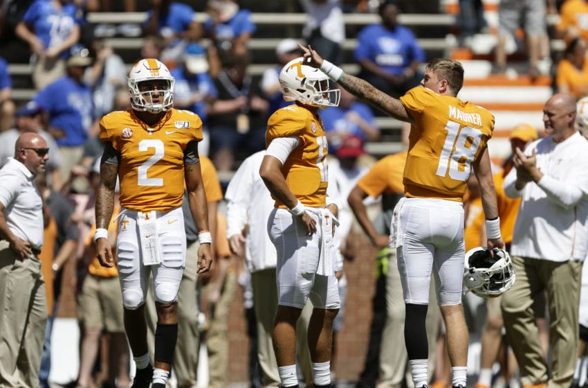 KNOXVILLE, TENNESSEE - AUGUST 31: Jarrett Guarantano #2, J.T. Shrout #12 and Brian Maurer #18 of the Tennessee Volunteers warm up before facing the Georgia State Panthers during the season opener at Neyland Stadium on August 31, 2019 in Knoxville, Tennessee. (Photo by Silas Walker/Getty Images)