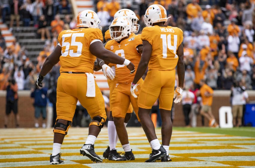 KNOXVILLE, TN - OCTOBER 12: Tim Jordan #9 of the Tennessee Volunteers celebrates with Brandon Kennedy #55 and Jerrod Means #14 after rushing for a fifteen yard touchdown during the first half of a game against the Mississippi State Bulldogs at Neyland Stadium on October 12, 2019 in Knoxville, Tennessee. (Photo by Carmen Mandato/Getty Images)
