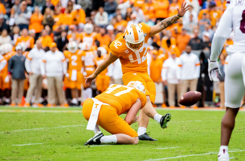 KNOXVILLE, TN - OCTOBER 12: Brent Cimaglia #42 kicks the ball held by Joe Doyle #47 of the Tennessee Volunteers against the Mississippi State Bulldogs at Neyland Stadium on October 12, 2019 in Knoxville, Tennessee. (Photo by Carmen Mandato/Getty Images)