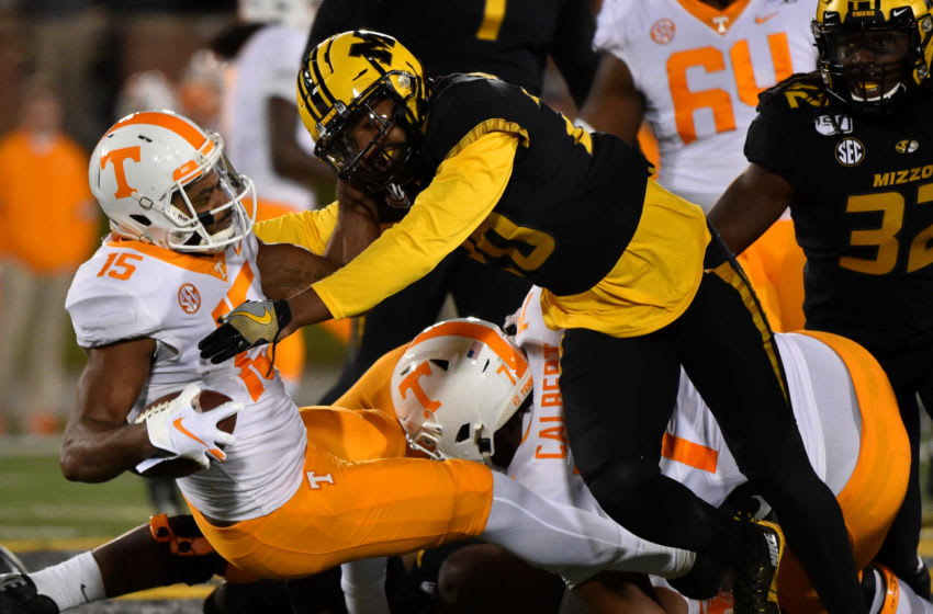 COLUMBIA, MISSOURI - NOVEMBER 23: Wide receiver Jauan Jennings #15 of the Tennessee Volunteers is tackled by defensive back Khalil Oliver #20 of the Missouri Tigers in the first quarter at Faurot Field/Memorial Stadium on November 23, 2019 in Columbia, Missouri. (Photo by Ed Zurga/Getty Images)