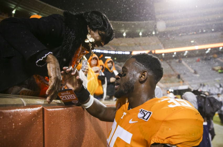 KNOXVILLE, TENNESSEE - NOVEMBER 30: Daniel Bituli #35 of the Tennessee Volunteers talks to his mother after the game against the Vanderbilt Commodores at Neyland Stadium on November 30, 2019 in Knoxville, Tennessee. (Photo by Silas Walker/Getty Images)