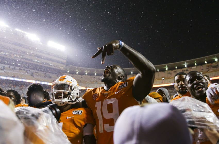 KNOXVILLE, TENNESSEE - NOVEMBER 30: Darrell Taylor #19 of the Tennessee Volunteers celebrates defeating the Vanderbilt Commodores during their senior night game at Neyland Stadium on November 30, 2019 in Knoxville, Tennessee. (Photo by Silas Walker/Getty Images)
