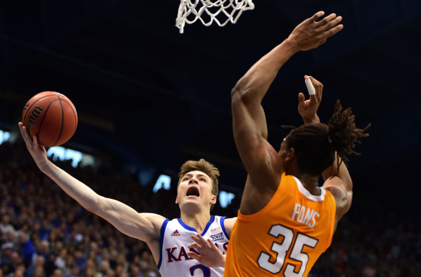 LAWRENCE, KANSAS - JANUARY 25: Christian Braun #2 of the Kansas Jayhawks lays the ball up against Yves Pons #35 of the Tennessee Volunteers in the first half at Allen Fieldhouse on January 25, 2020 in Lawrence, Kansas. (Photo by Ed Zurga/Getty Images)