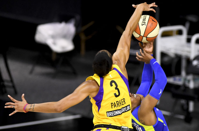 PALMETTO, FLORIDA - AUGUST 23: Arike Ogunbowale #24 of the Dallas Wings has her shot blocked by Candace Parker #3 of the Los Angeles Sparks defends during the second half at Feld Entertainment Center on August 23, 2020 in Palmetto, Florida. NOTE TO USER: User expressly acknowledges and agrees that, by downloading and or using this photograph, User is consenting to the terms and conditions of the Getty Images License Agreement. (Photo by Douglas P. DeFelice/Getty Images)