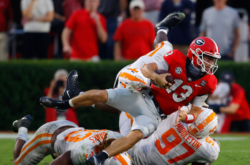 ATHENS, GEORGIA - OCTOBER 10: Stetson Bennett #13 of the Georgia Bulldogs dives for more yardage against Jeremy Banks #33, Darel Middleton #97, and Matthew Butler #94 of the Tennessee Volunteers during the second half at Sanford Stadium on October 10, 2020 in Athens, Georgia. (Photo by Kevin C. Cox/Getty Images)