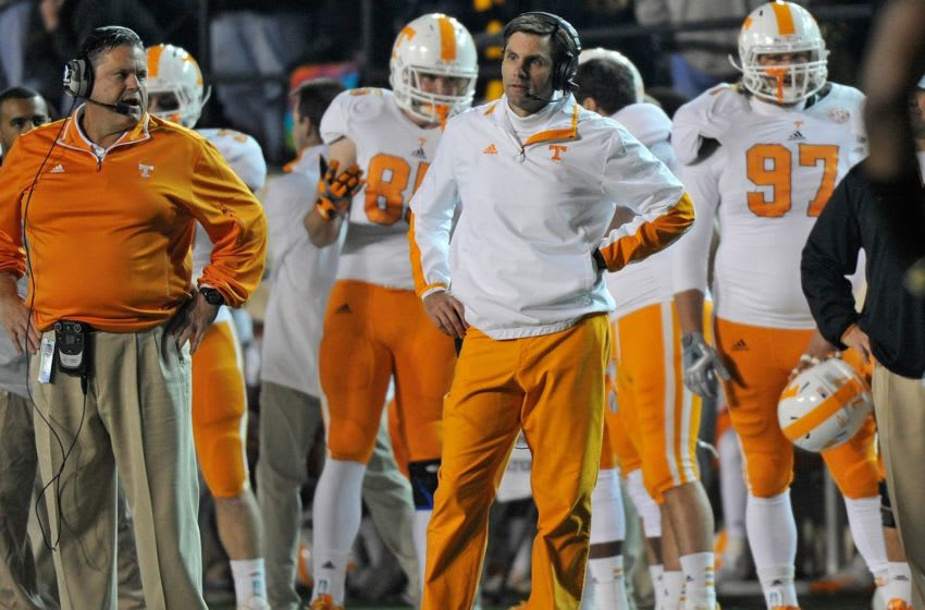 NASHVILLE, TN - NOVEMBER 17: Head coach Derek Dooley of the University of Tennessee reacts to a call during a 41-18 loss against the Vanderbilt Commodores at Vanderbilt Stadium on November 17, 2012 in Nashville, Tennessee. (Photo by Frederick Breedon/Getty Images)