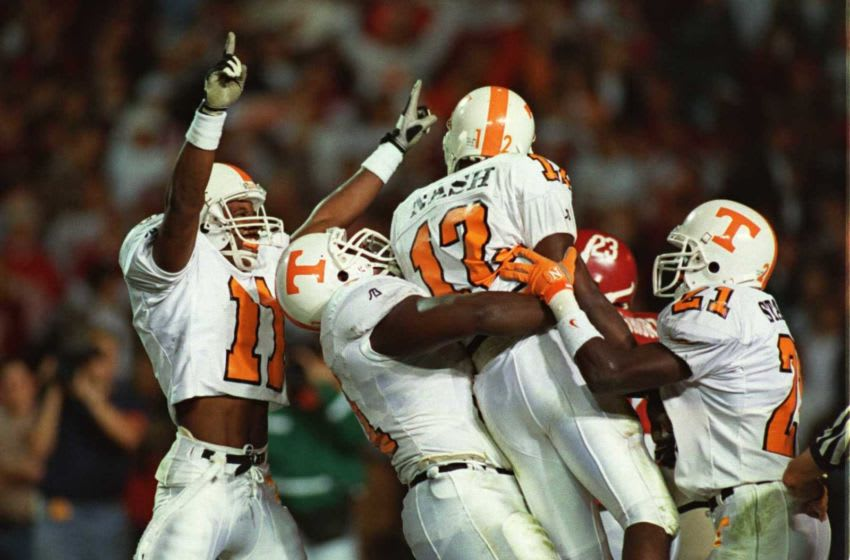 14 Oct 1995: TENNESSEE PLAYERS CELEBRATE AFTER WIDE RECEIVER MARCUS NASH SCORED HIS SECOND TOUCHDOWN AGAINST ALABAMA DURING THE SECOND QUARTER OF THE VOLUNTEERS 41-14 VICTORY OVER THE CRIMSON TIDE AT LEGION FIELD IN BIRMINGHAM, ALABAMA.
